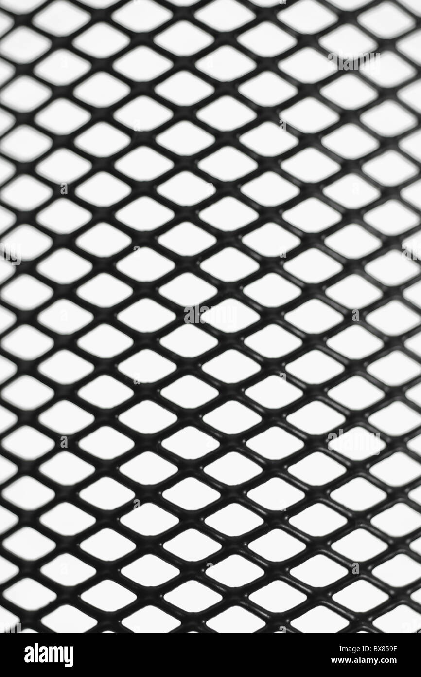 Black wire mesh pattern on white background - Stock Image