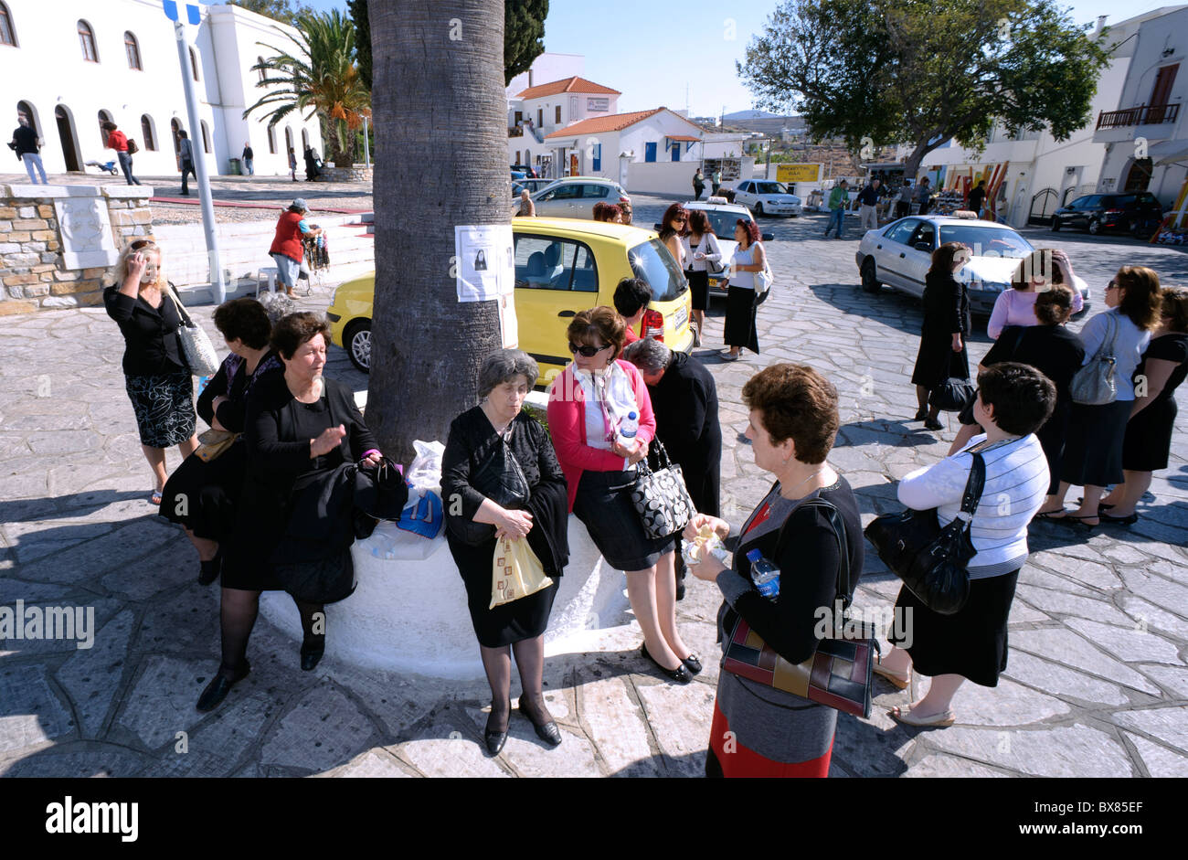 Group of women waiting outside Panagia Evangelistria, the most revered religious shrine in Greece. - Stock Image