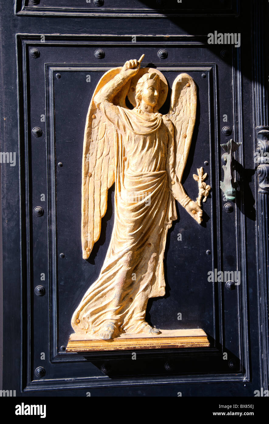 Carving of an angel on a entrance door leading to Panagia Evangelistria, the most revered religious shrine in Greece. - Stock Image