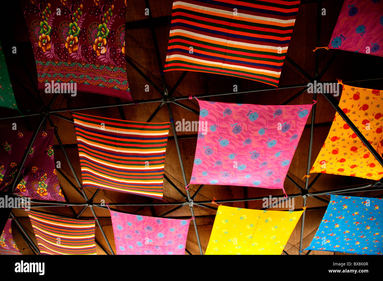 Different design of cloths arranged to decorate a roof ceiling  inside the house - Stock Image