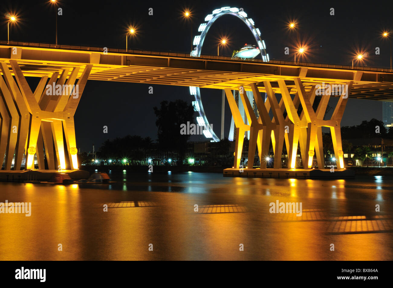 The Benjamin Sheares Bridge spanning the Kallang River and overlooking the Singapore Flyer. Stock Photo