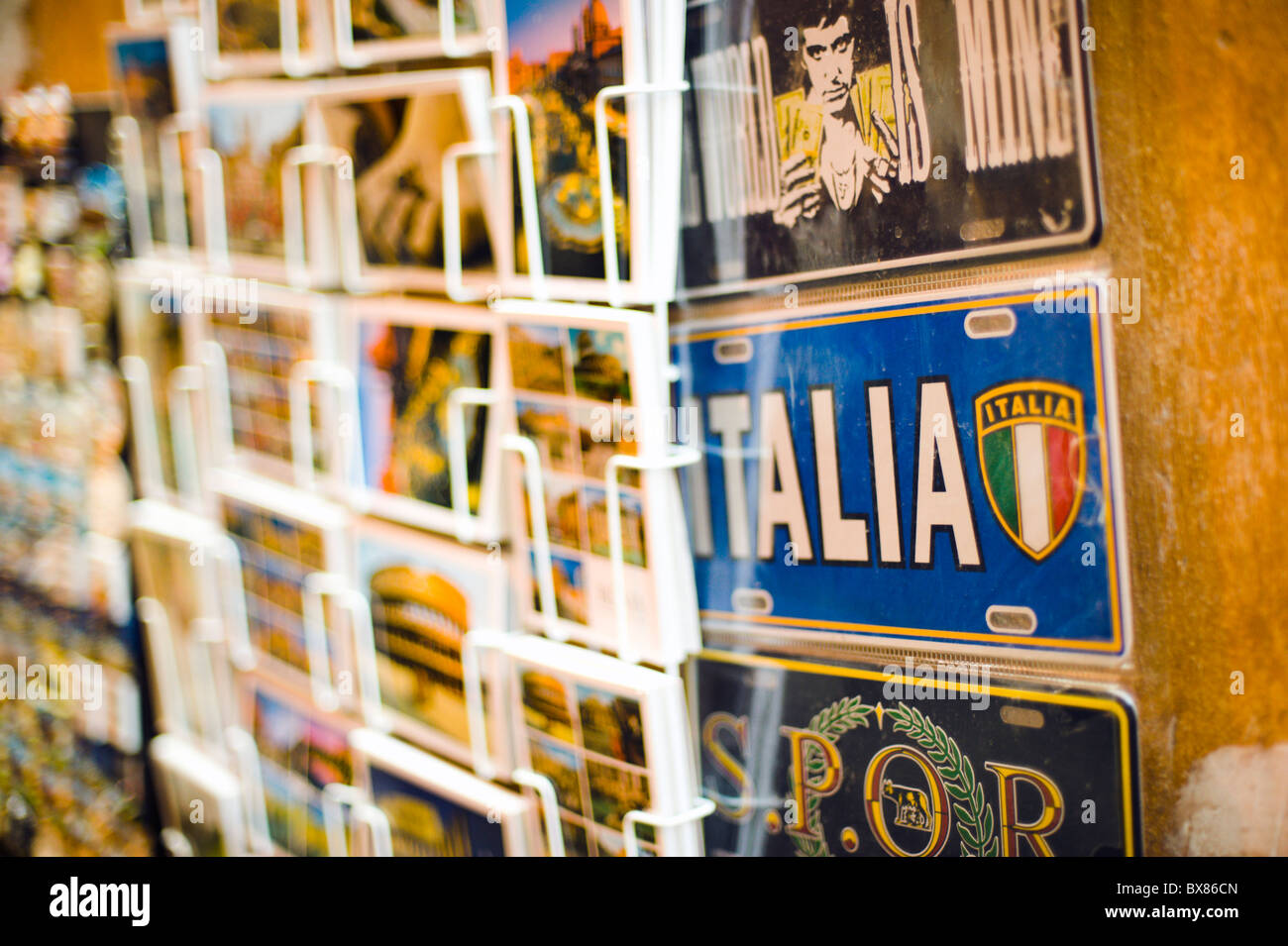 Night photo of postcards for sale at a newsstand, shallow DOF - Stock Image
