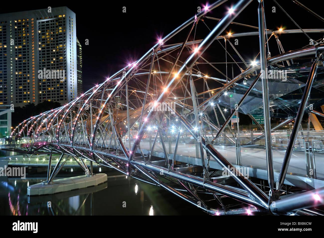 The iconic Double Helix Bridge in Singapore overlooking the Marina skyline. Stock Photo