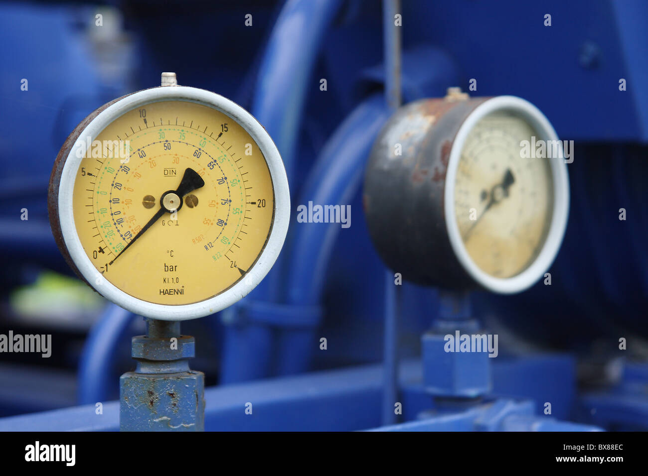 Old pressure gauge on a pump. Stock Photo
