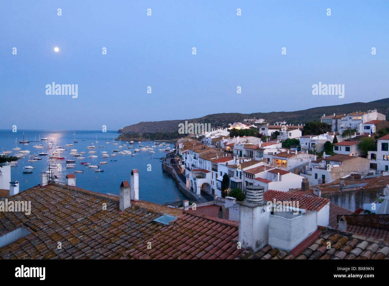 Moon rising in the Mediterranean sea over Cadaques - Stock Image