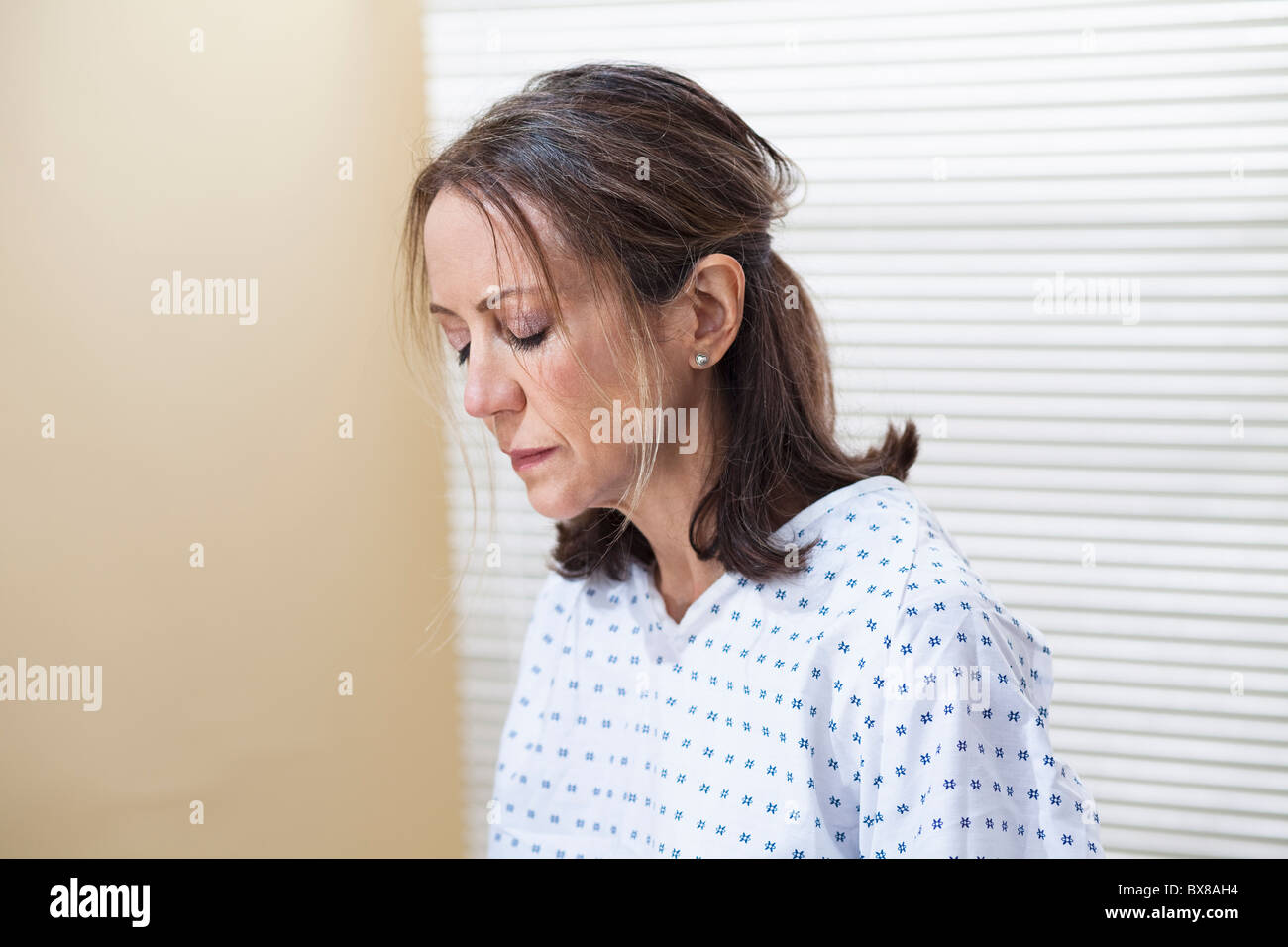 Woman in examination room - Stock Image