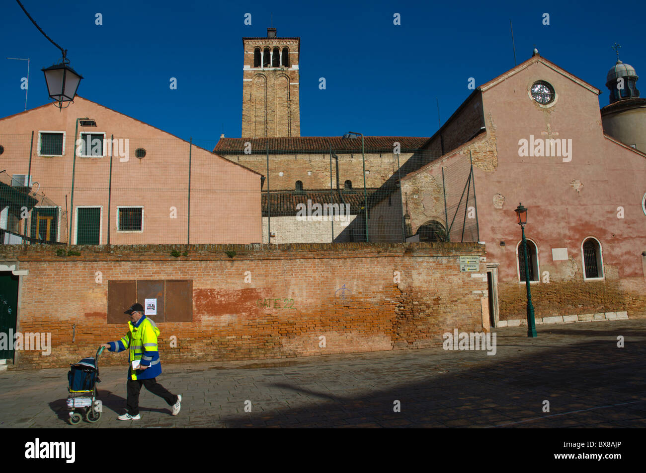 Postman at Campo San Giacomo dell'Orio (da l'Orio) square in Santa Croce district Venice the Veneto northern - Stock Image