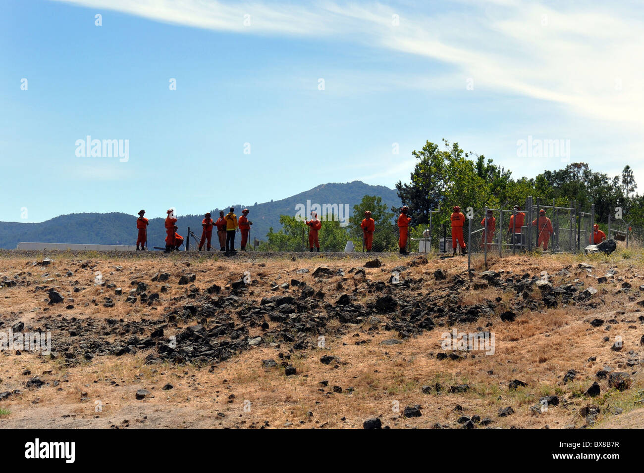 Prisoners repair a road as part of their rehabilitation back into the community, North California, USA - Stock Image