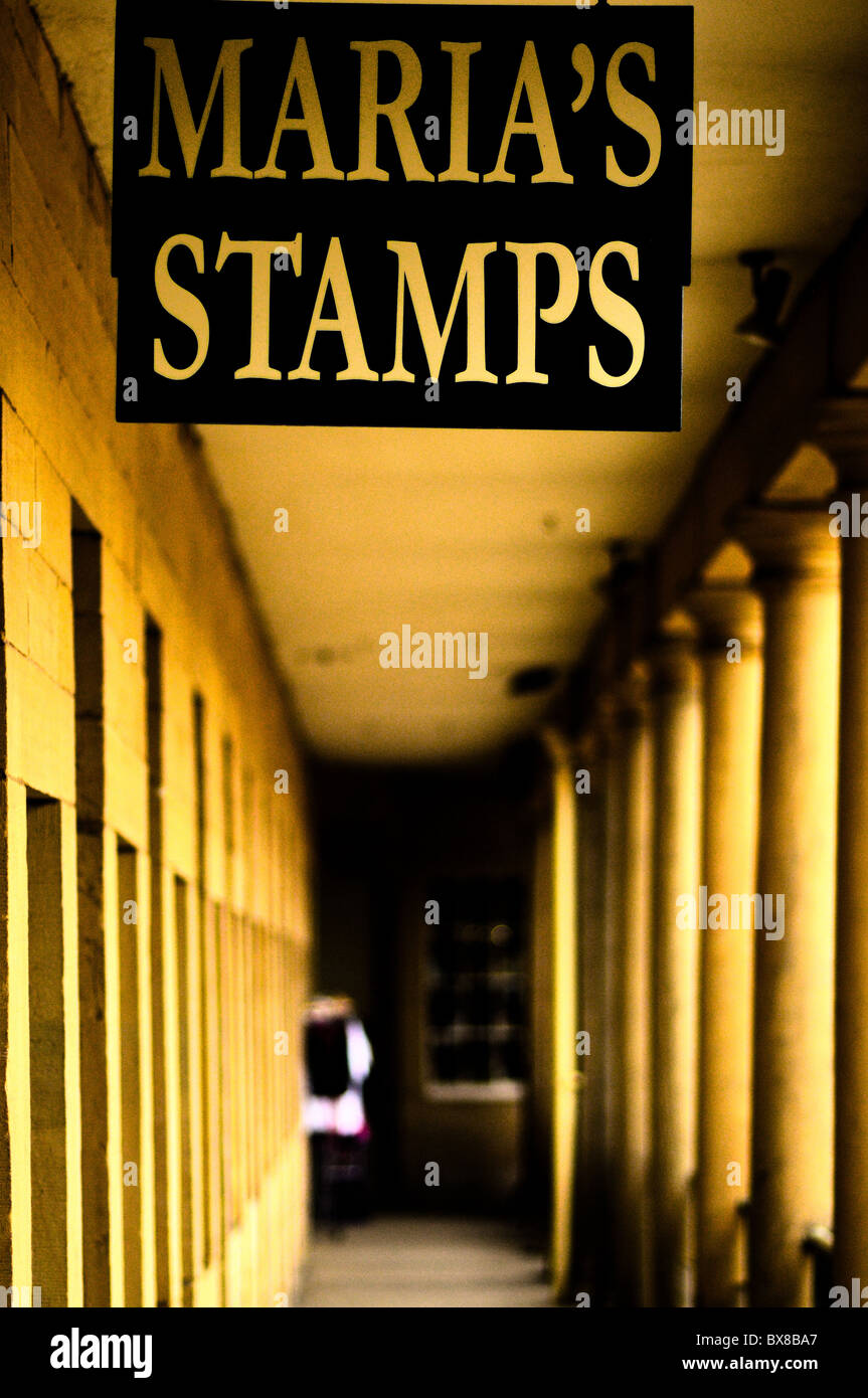 Converted shops from an old industrial mill.  Here is the sign of a stamp seller - Stock Image