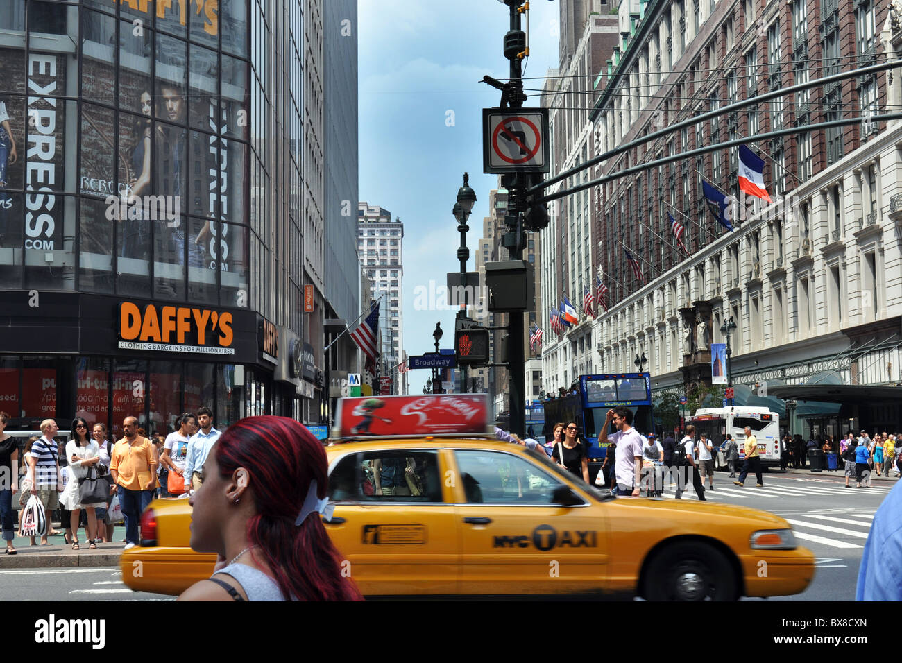 Broadway, New York City on a busy hot August Day - Stock Image