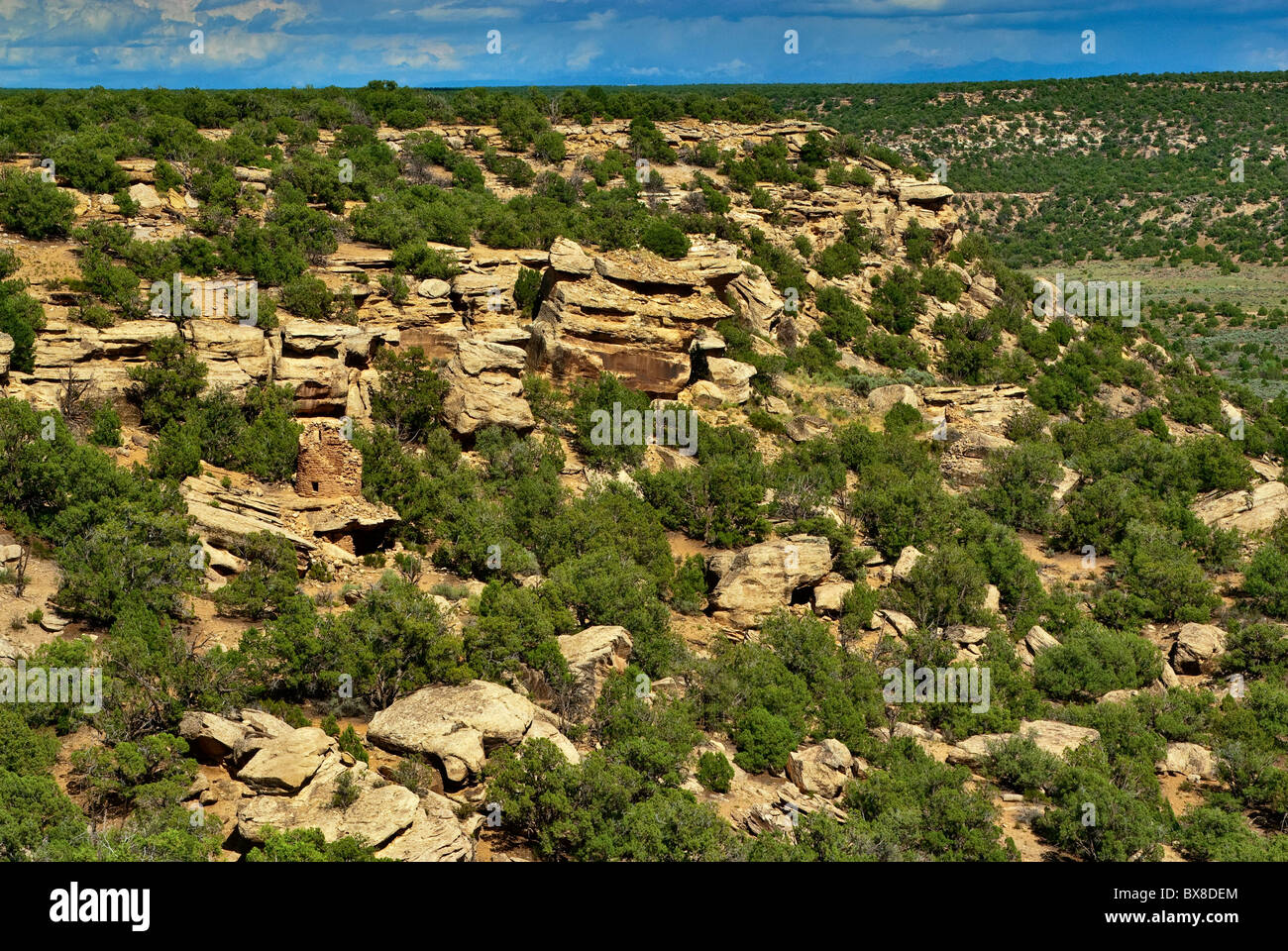Distant view of Anasazi ruins at Painted Hand Pueblo at Canyons of the Ancients National Monument, Colorado, USA - Stock Image