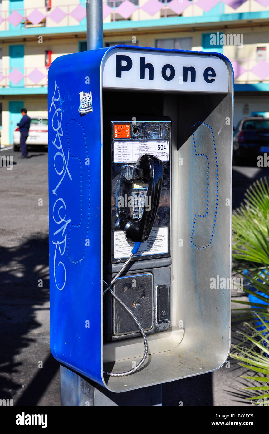 Pay phone with graffiti outside motel in Las Vegas - Stock Image