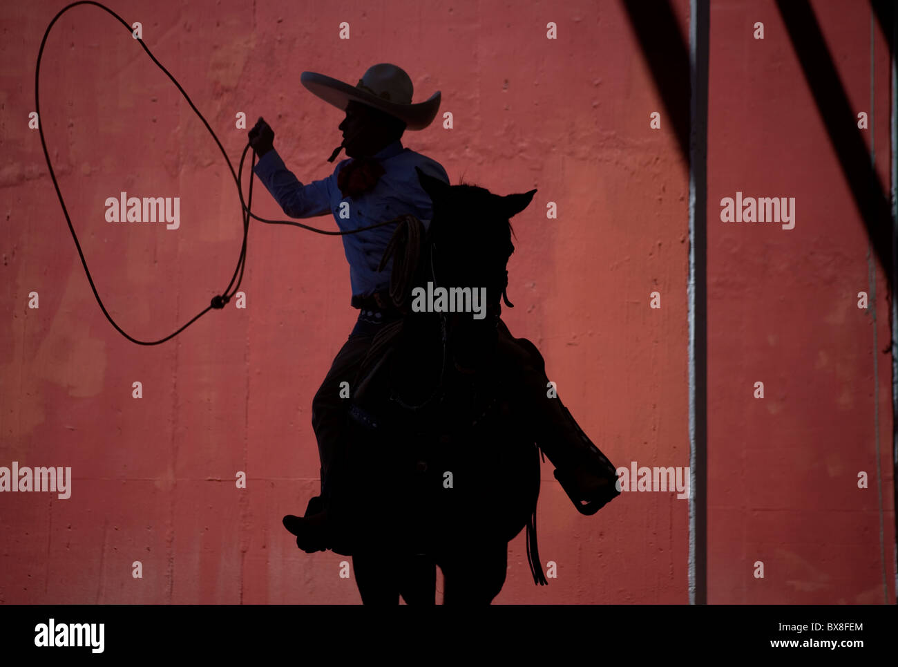 A Mexican charro practices his lasso at the National Charro Championship in Pachuca, Hidalgo State, Mexico - Stock Image