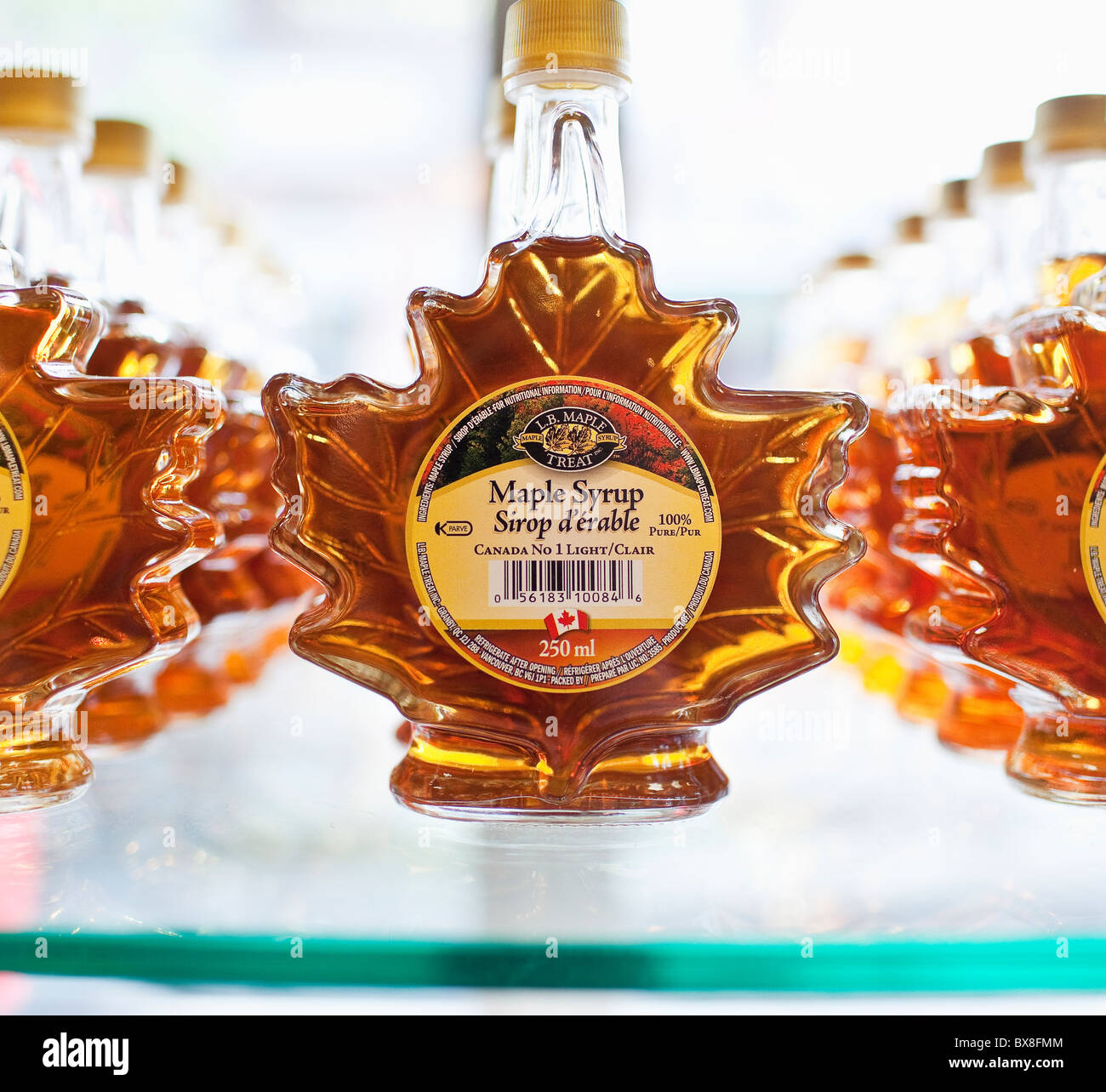 Canadian Maple Syrup in glass bottles. - Stock Image