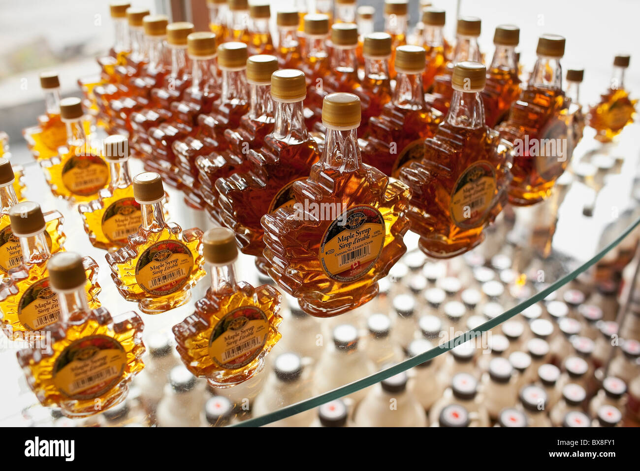 Maple Syrup in glass bottles. - Stock Image