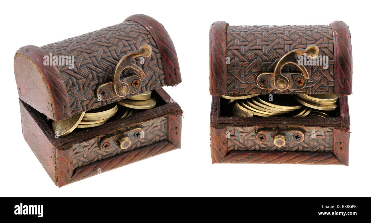 Buried treasure - miniature of an chest with treasure inside - Stock Image