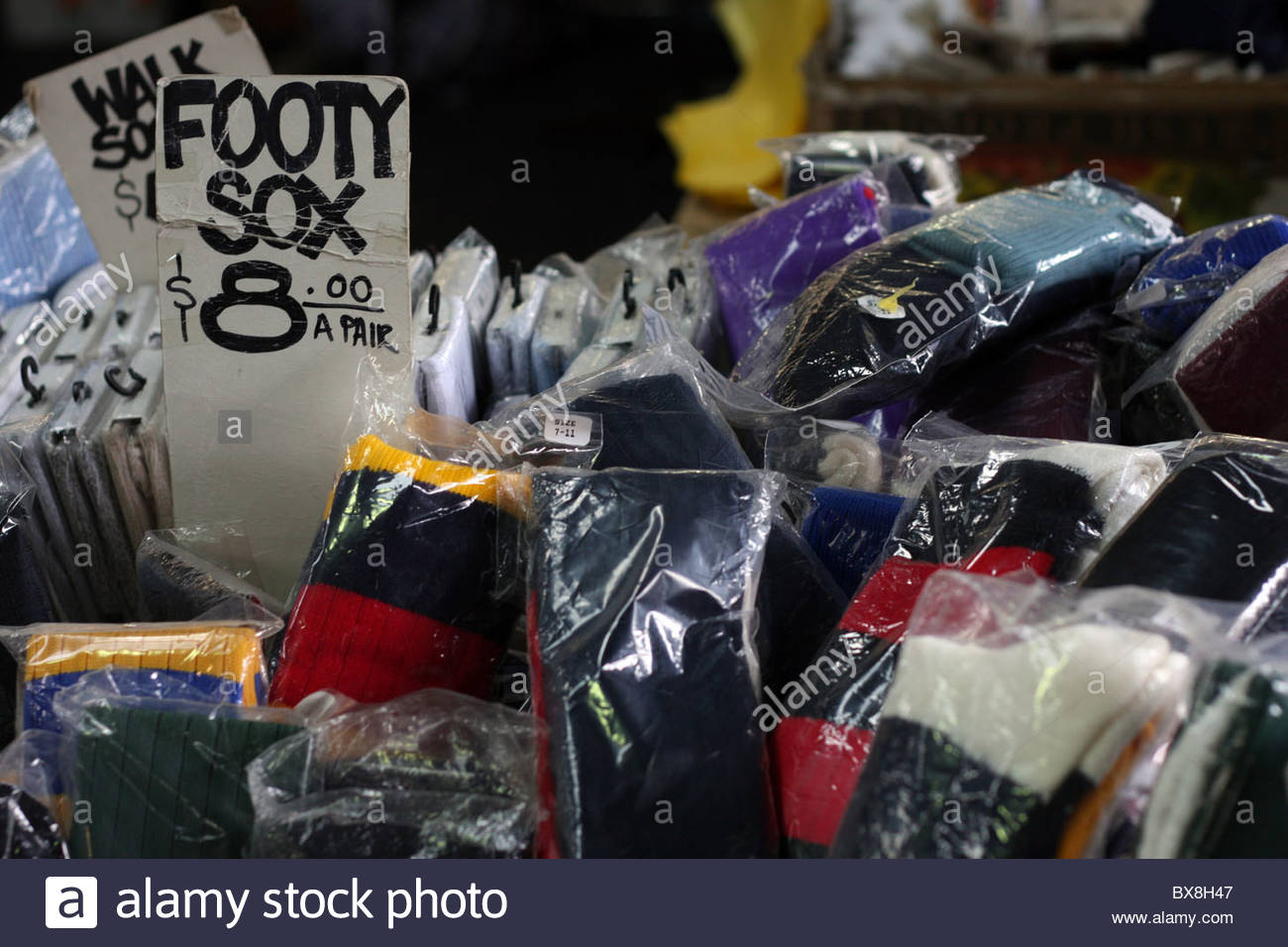 Packets of football socks in a bin for sale at Melboure's Queen Victoria  Market. -