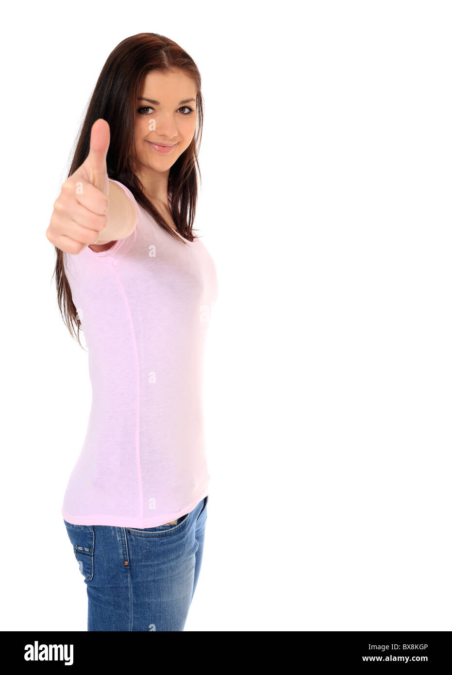 Attractive teenage girl making positive gesture. All on white background. - Stock Image