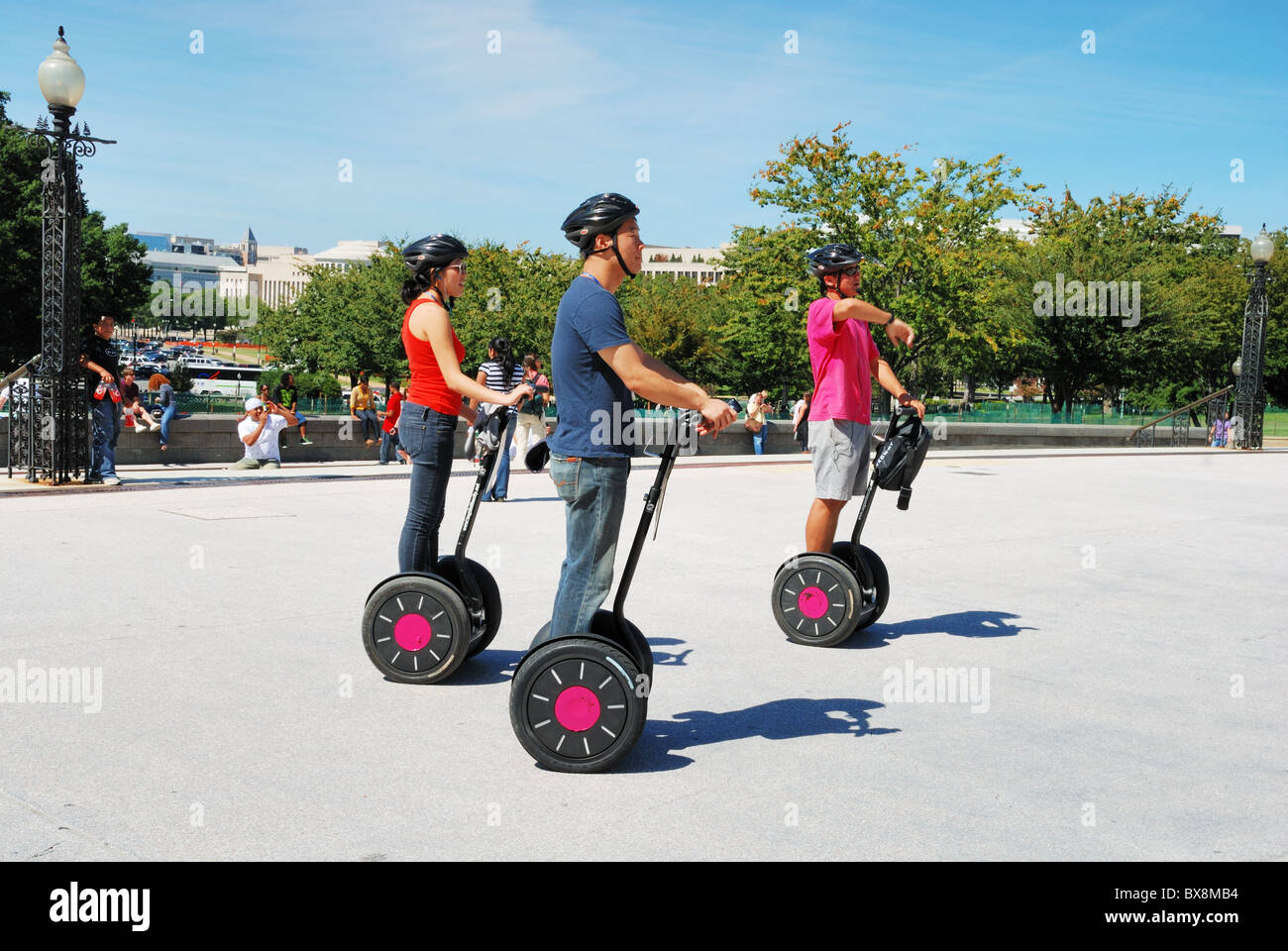 Sightseer tourists on Segway personal transporters in Washington, DC. - Stock Image