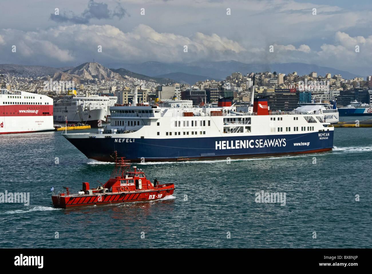 Hellenic Seaways car and passenger ferry Nefeli leaving Piraeus harbour in Greece - Stock Image