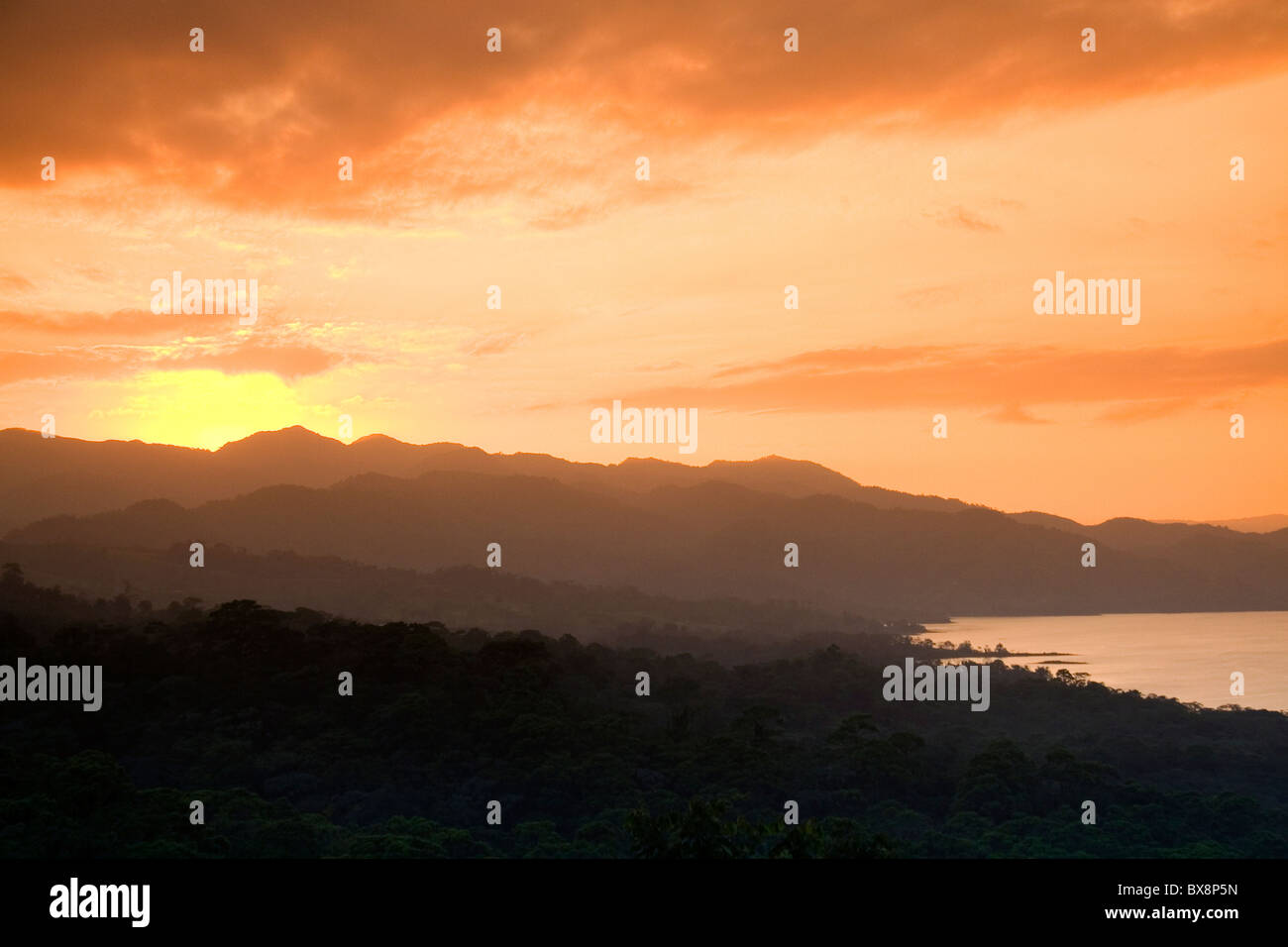 Sunset over the Cordillera Central from the Arenal Volcano National Park near La Fortuna, San Carlos, Costa Rica. - Stock Image