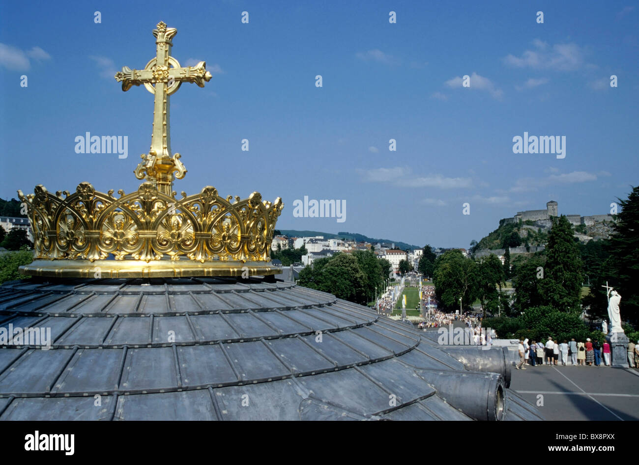 Gilded cross on top of the rooftop dome of the Rosary Basilica in Lourdes, France. Stock Photo