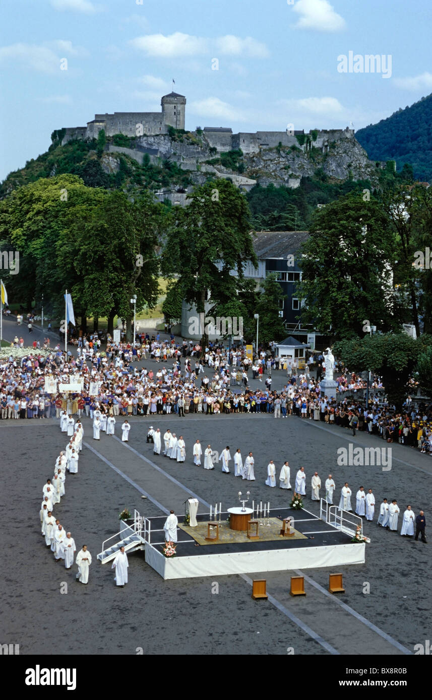 Priests leading mass outside in the Rosary Square, near the Rosary Basilica, Lourdes, France. Stock Photo