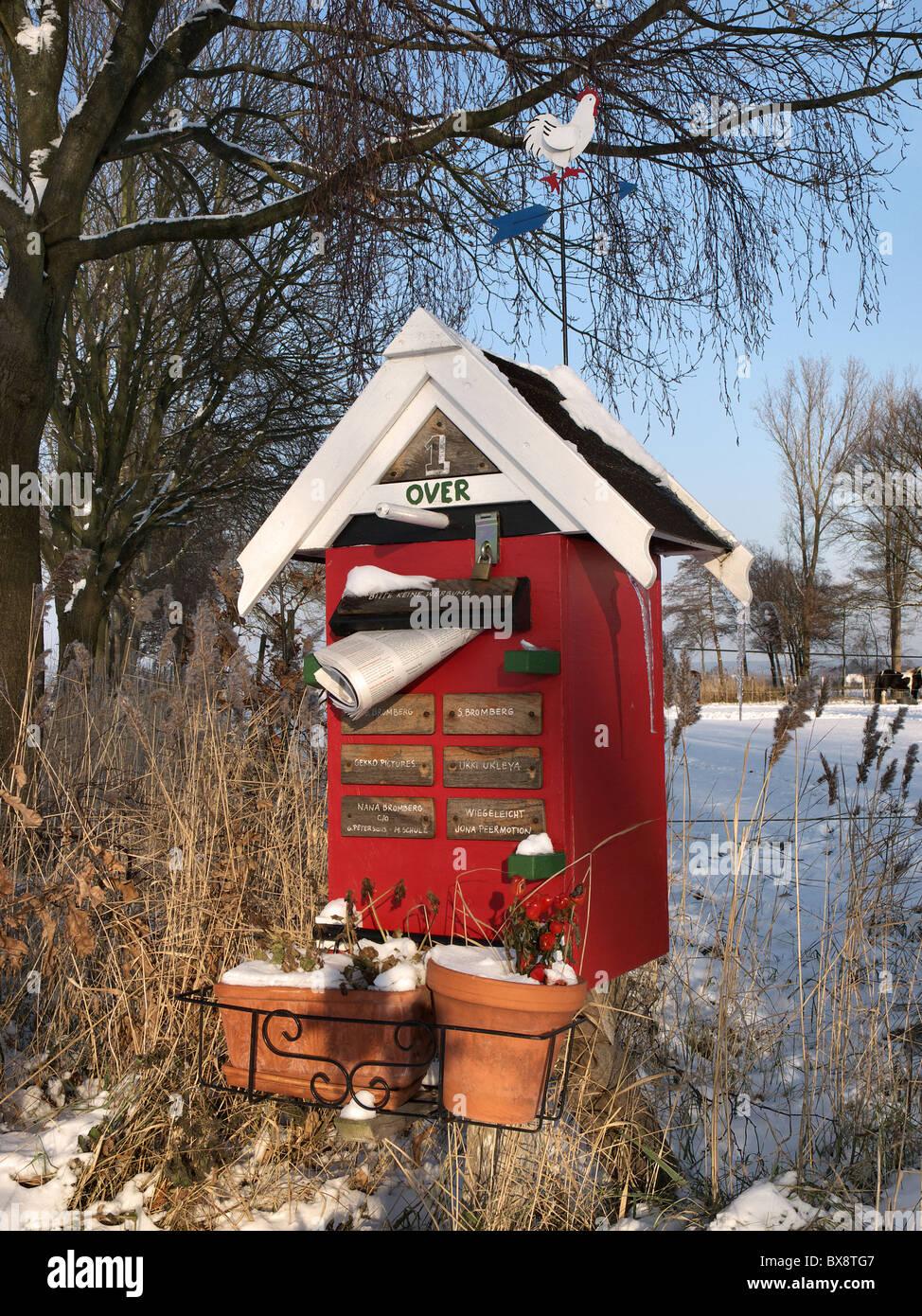 Funny mailbox at a farm in Barum, Elbmarsch, Niedersachsen, Germany. - Stock Image