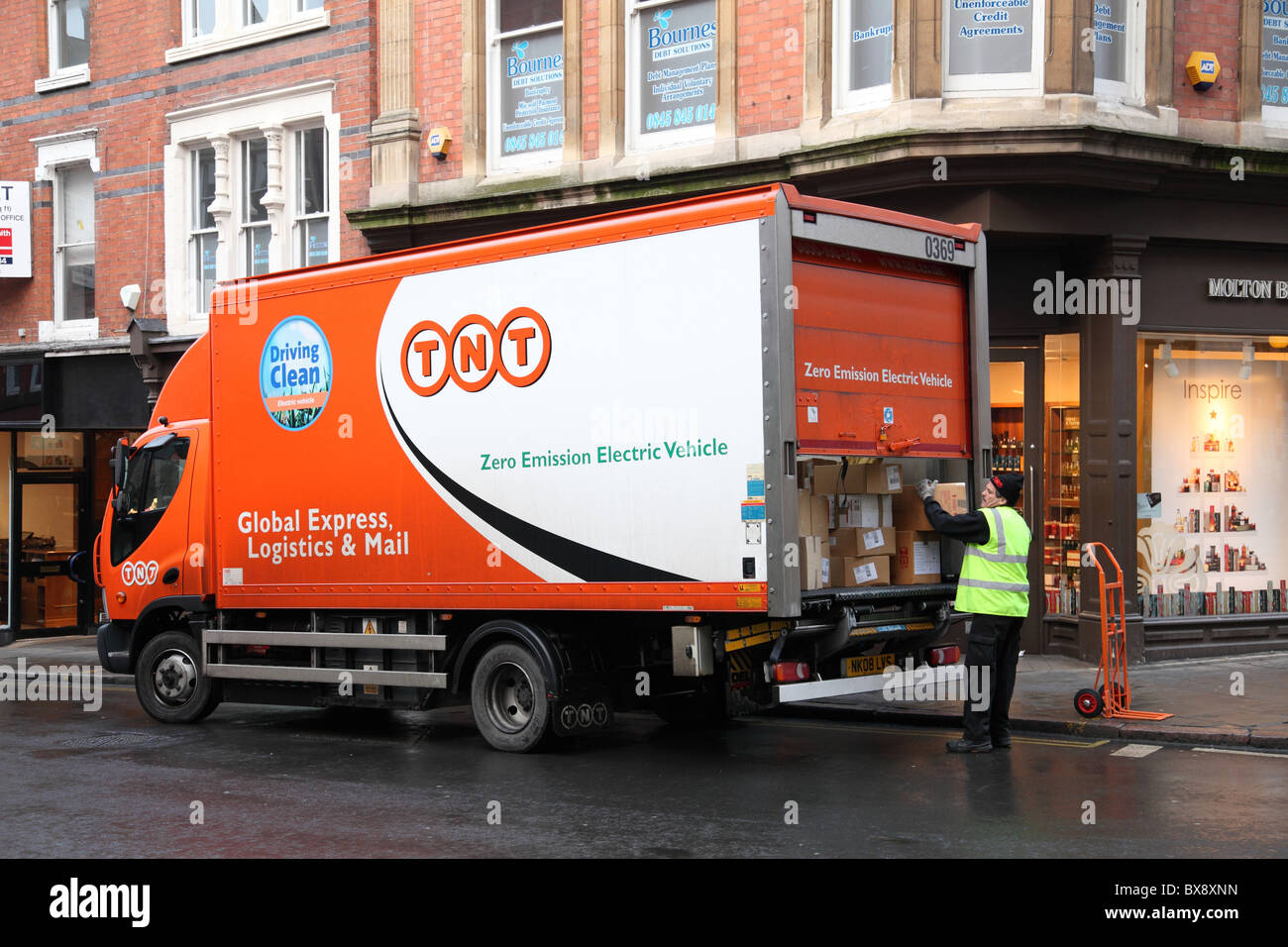 A TNT zero emission electric vehicle on a U.K. street. - Stock Image