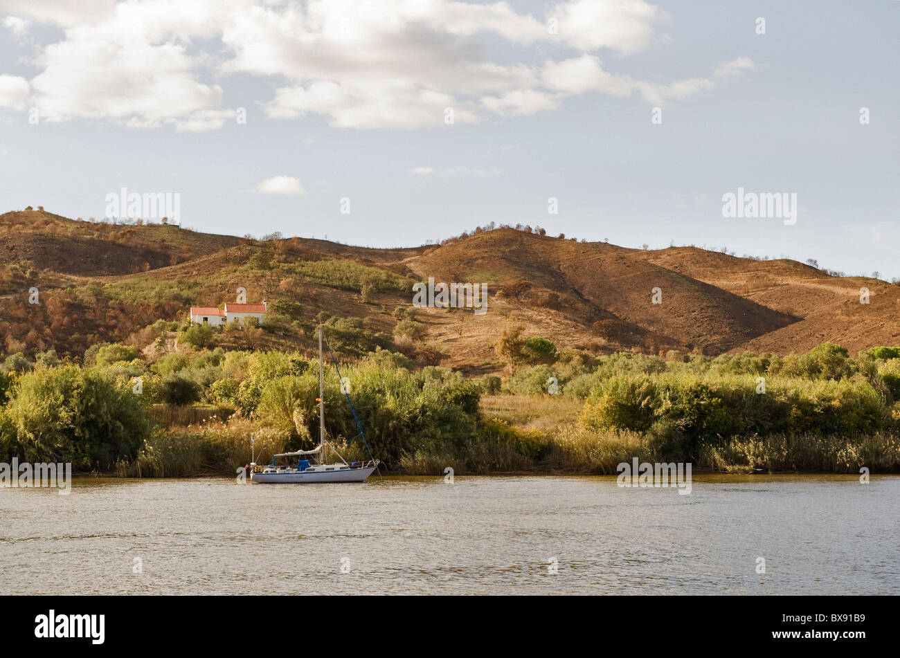 Yacht anchored on the river Guadiana near Alcoutim. The river forms a natural boarder between Spain and Portugal - Stock Image