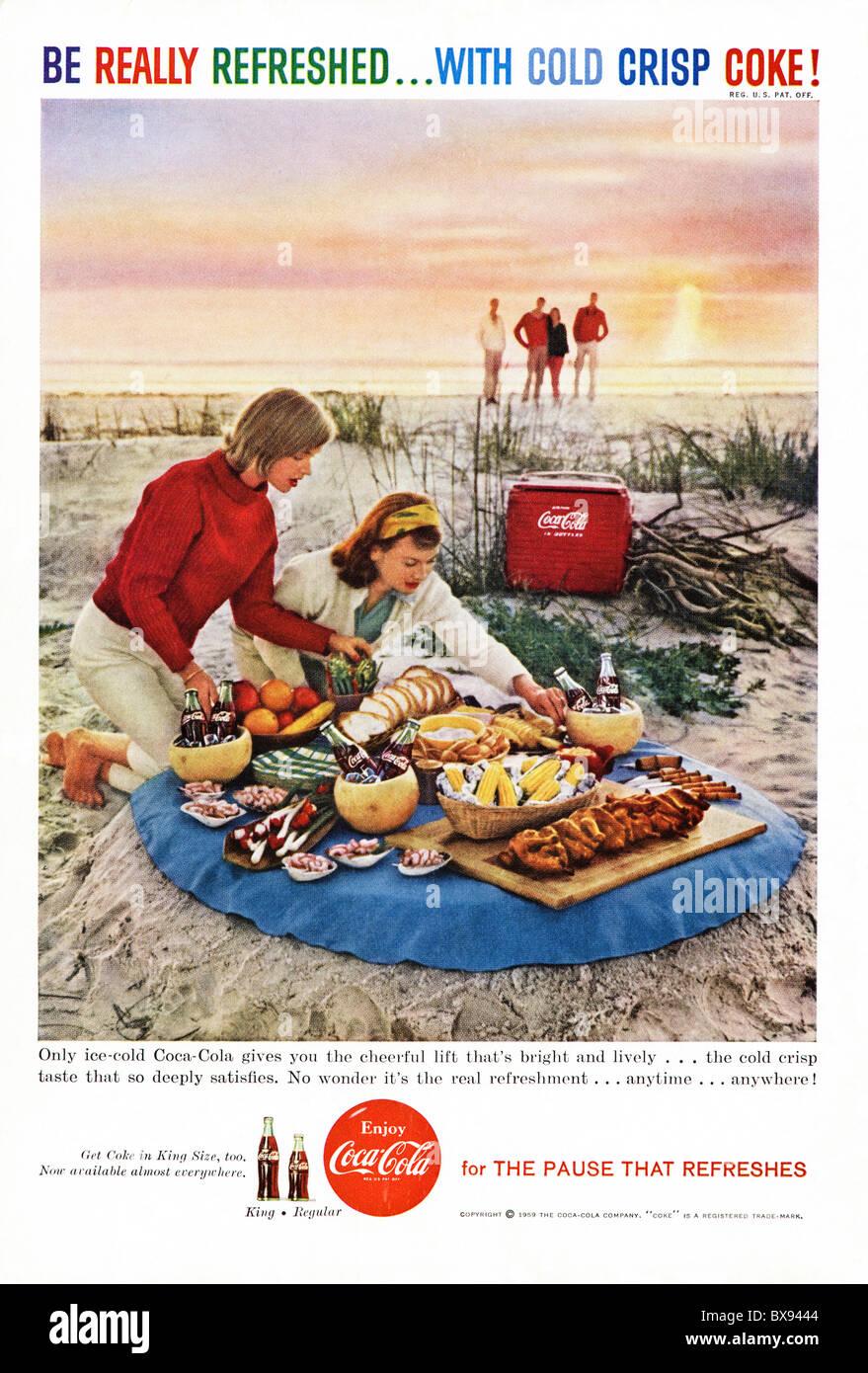 Classic Coca Cola colour advert featuring illustration of Californian beach scene in American magazine circa 1959 - Stock Image