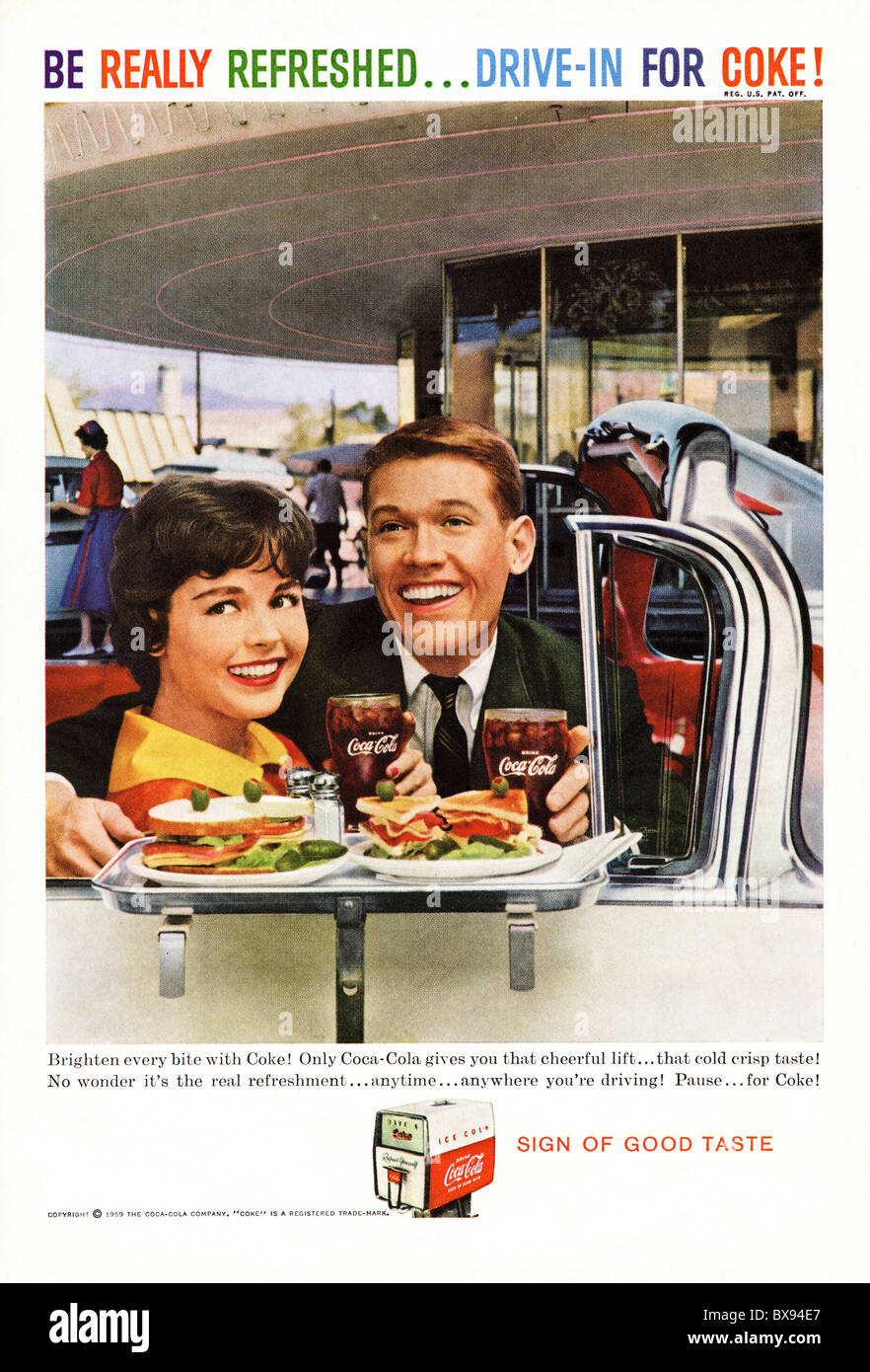 Classic Coca Cola colour advert featuring illustration of drive through scene with young couple in American magazine - Stock Image