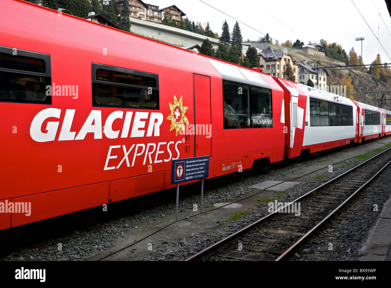 Panoramic railcars electric powered train Rhaetian Railway  Glacier Express train station St. Moritz - Stock Image