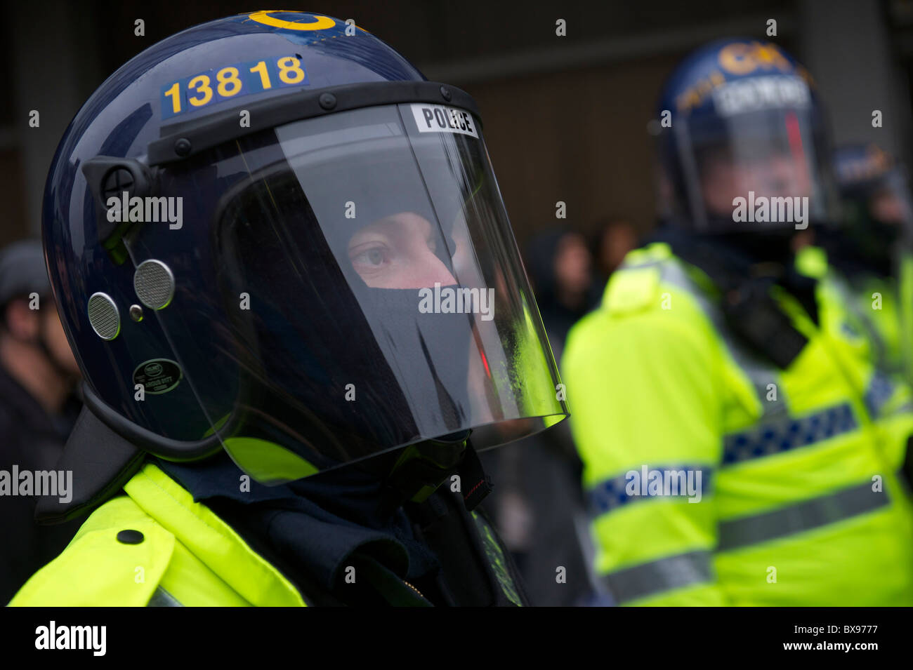 A phalanx of police officers, numbering in excess of 1,400, equipped with riot gear and security dogs, kept a rally Stock Photo