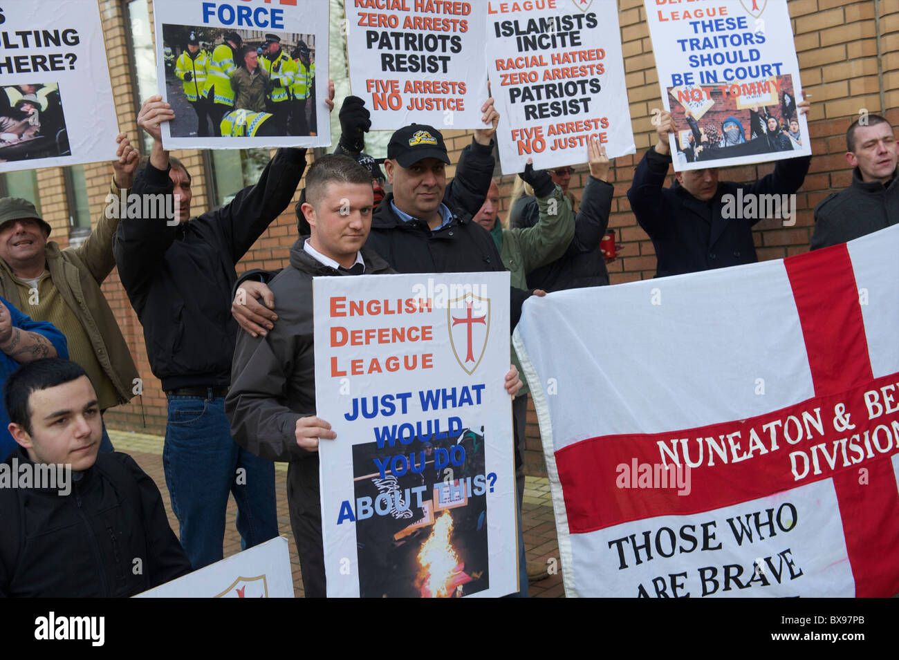 English Defence League (EDL) leader Tommy Robinson, also known as Stephen Lennon, and supporters arrive at the West - Stock Image
