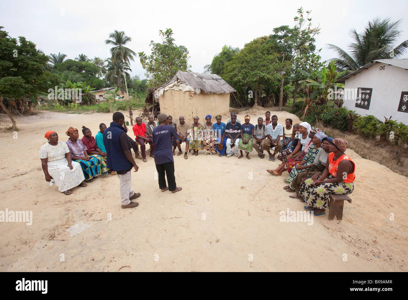 Villagers attend a community meeting in the town of Kakata, Liberia, West Africa. - Stock Image