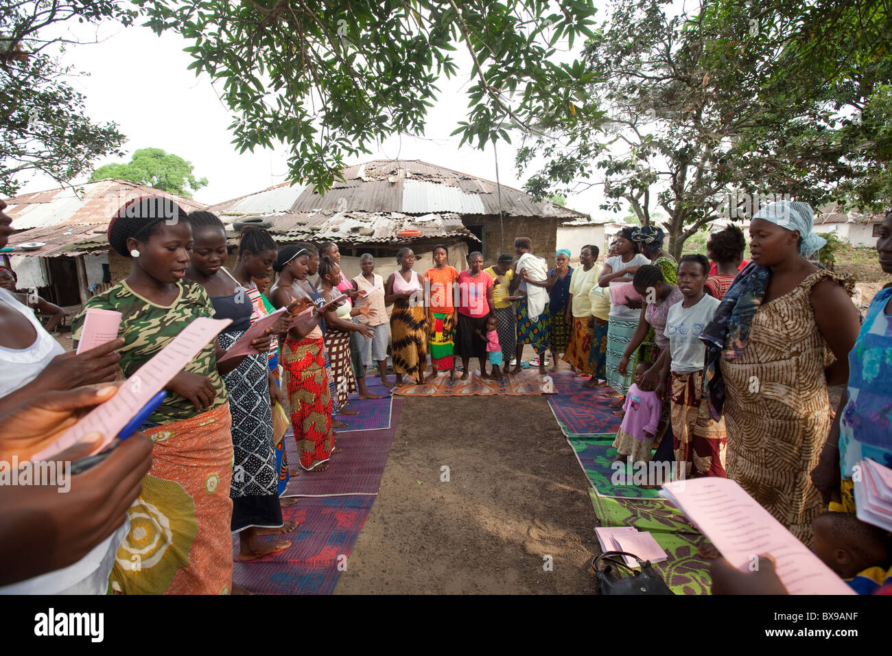 Women attend a community microfinance meeting in Kakata, Liberia, West Africa. - Stock Image
