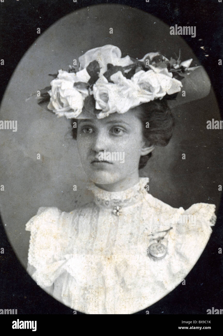 787a1b718b21 young woman wearing Edwardian Victorian period tea hat flowers Americana  black and white fashion head gear