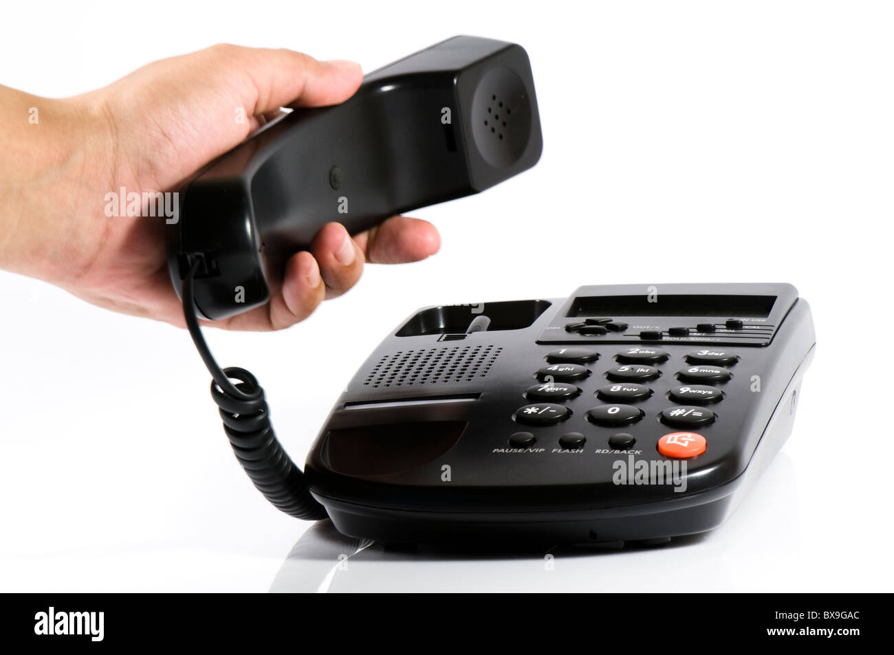 Picking phone receiver cutout, black telephone, white background - Stock Image