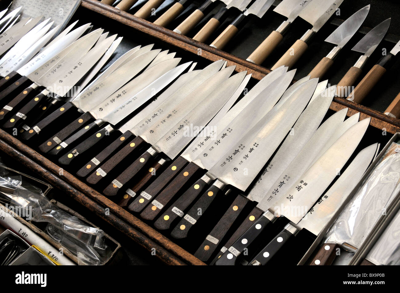 knifes on stale, Fish market, Tokyo, Japan - Stock Image