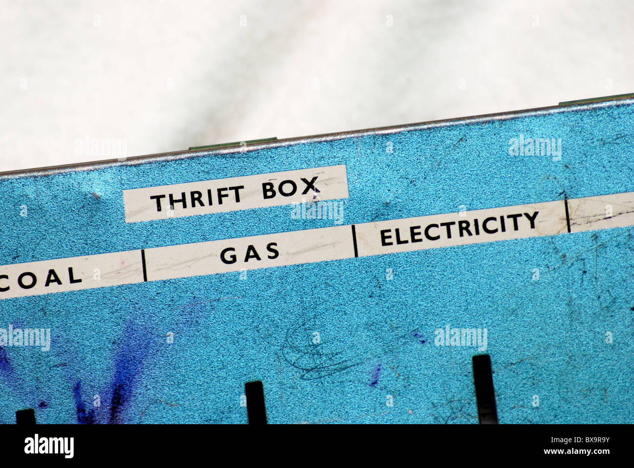 old thrifty savings tin for bills england uk - Stock Image