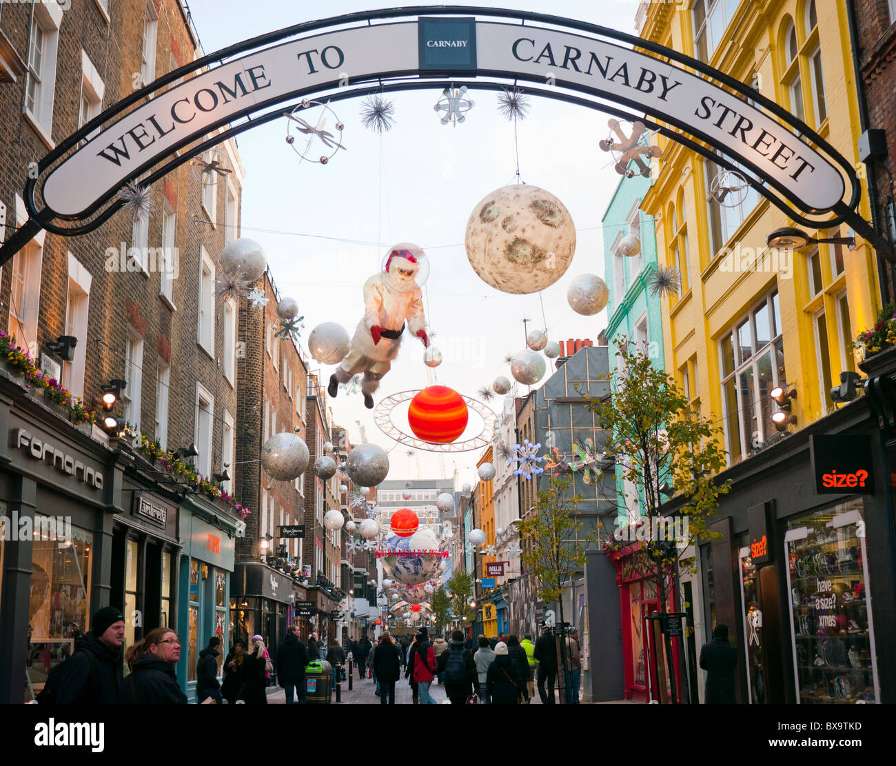 Christmas decorations and lights in Carnaby Street in London's West End in Britain - Stock Image