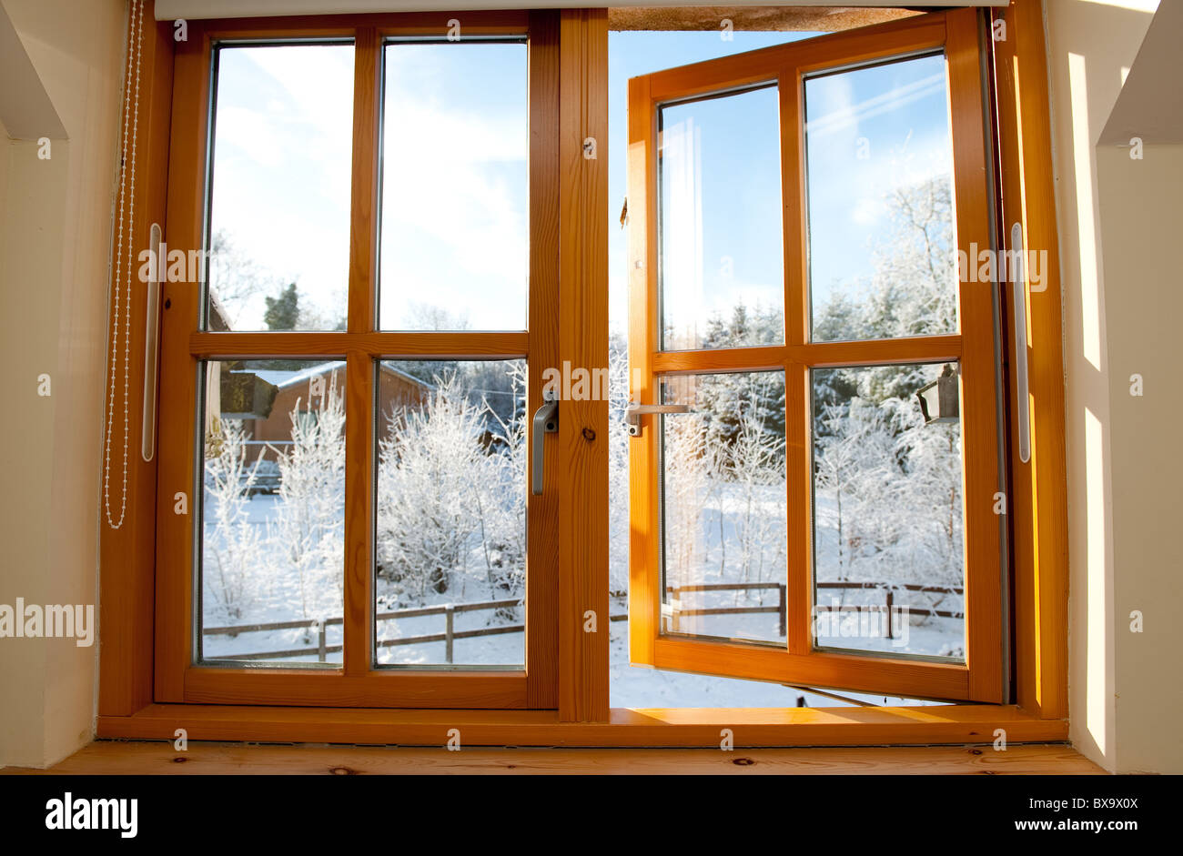Early morning frosty winter view through a window. - Stock Image