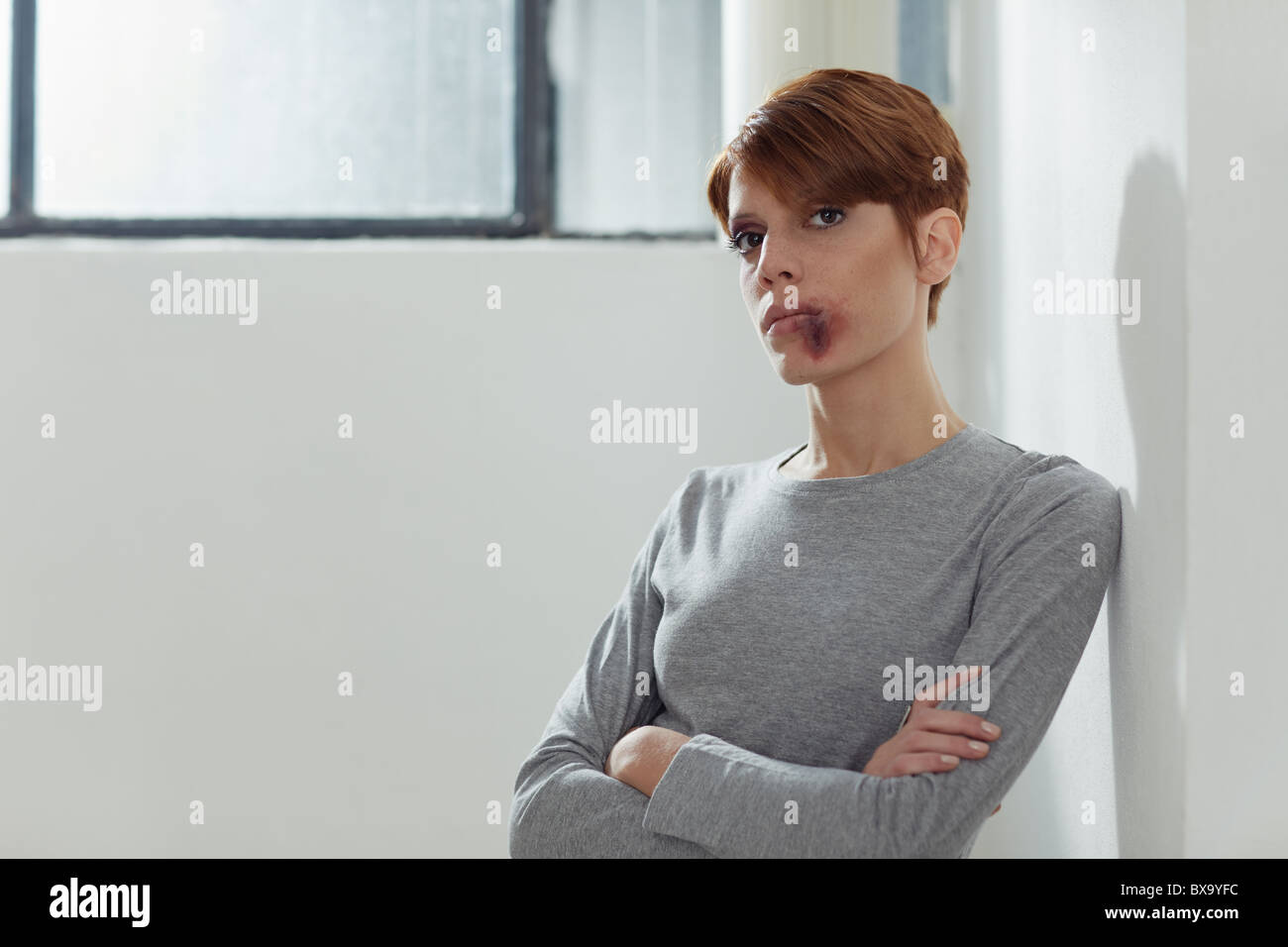 portrait of young caucasian woman being abused. Horizontal shape, front view, copy space - Stock Image