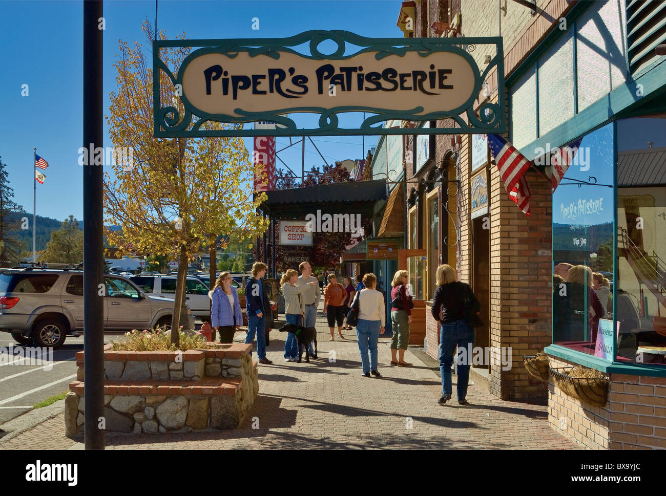 Art nouveau store sign, tourists at Commercial Row at Donner Pass Rd in Truckee, in northern Sierra, California, - Stock Image