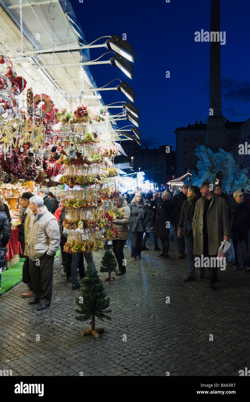 Piazza Navona Christmas market in Rome with passerbies - Stock Image