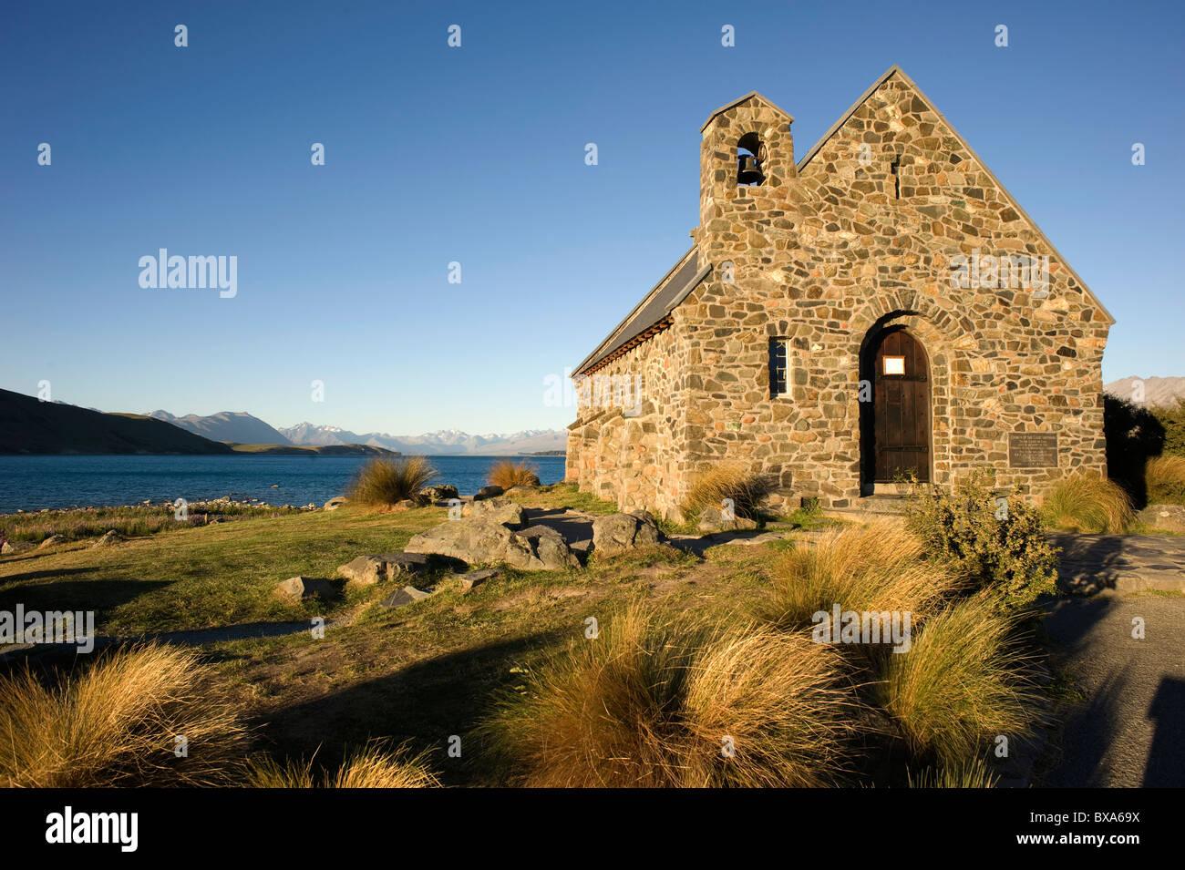 The evening sun catches the Church of the Good Shepherd on the shores of Lake Tekapo, Tekapo, New Zealand. - Stock Image