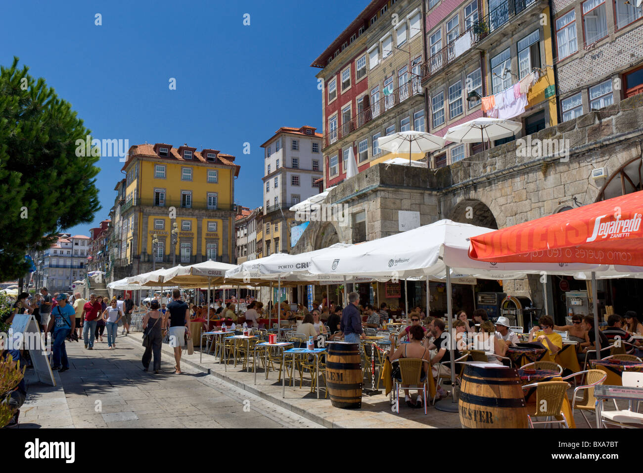 Portugal, Porto, quayside restaurants in the Ribeira district of town with the Pestana Porto Hotel - Stock Image