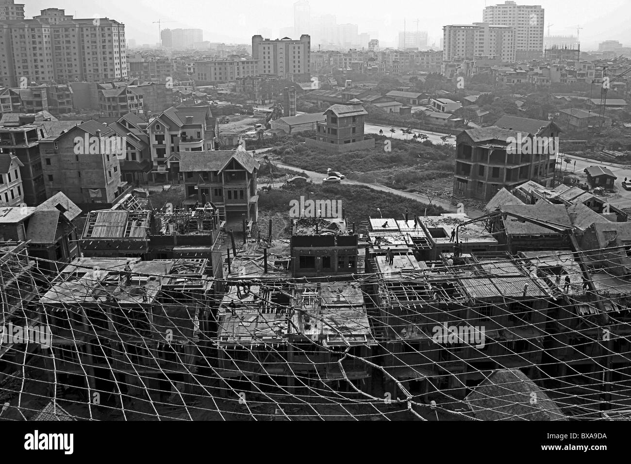 Taken in the Cau Giay district in HanoÏ, Vietnam. It shows urbanization process in the Vietnamese city. - Stock Image