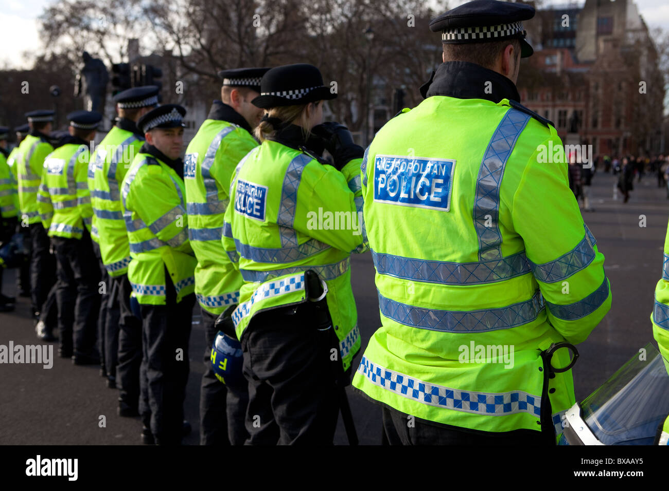 Line of metropolitan police in Parliament Square during tuition fees demonstration. - Stock Image